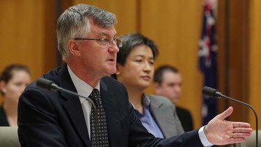 Two hats: Martin Parkinson with Finance Minister Penny Wong.