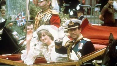 Royal carriage... The Princess and Prince of Wales wave on their wedding day, July 29, 198. Photo: AP