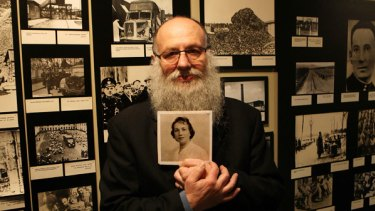 Jewish Holocaust Centre director Bernard Korbman with a picture of his mother, who was forced to work with Josef Mengele