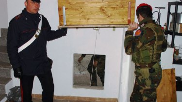 Italian police reveal a secret bunker where an alleged Mafia boss was found and arrested during the raids.