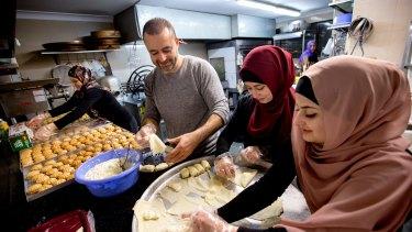Dallal Neeman, Abdul Neeman, Fatima El-Kabbout and Nurah Neeman bake thousands of sweets for Ramadan.