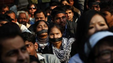 Women wear black bands across their face as they join a gathering mourning the death of a gang rape victim in New Delhi, India.