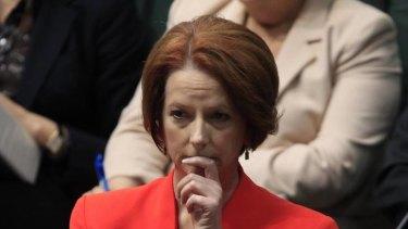 Prime Minister Julia Gillard listens to Liberal MP Michael Keenan speak during the debate about the Oakeshott  asylum seeker Bill.