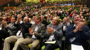 Physicists applaud the Higgs boson announcement in Melbourne.