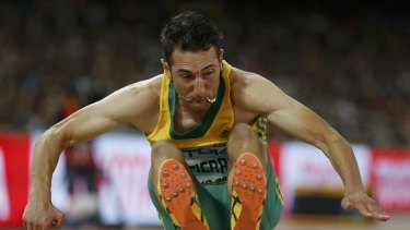 Fabrice Lapierre competes in the men's long jump final.