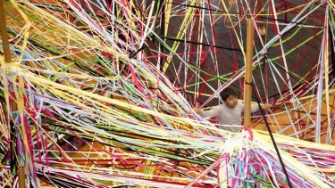 Children will take over the Arts Centre forecourt with coloured elastic.