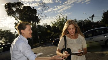 Kelly O'Dwyer hands out election material while on the campaign trail at Tooronga Station.