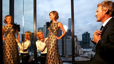 Channel Nine head stylist Cheryl Weir styles Elise Mooney, who wears a Mathieu Salem gown and Temelli jewellery, and Jules Lund, in a Dom Bagnato suit, at the Crown Metropol.