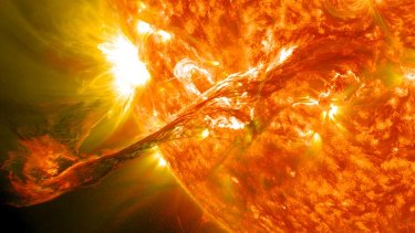 A  long filament of solar material that had been hovering in the sun's atmosphere, the corona, erupts out into space.