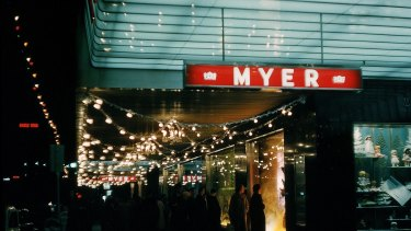 Shoppers in the 1950s admire the Myer Christmas windows.