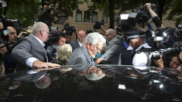 Guilty: Rolf Harris leaves the court after being found guilty of 12 counts of indecent assault.