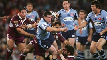 Finding his feet: Paul Gallen attempts to break through the Maroons defence during game three of the 2007 State of Origin series.
