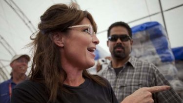 Reaching out ... Sarah Palin in Cabaret, Haiti.