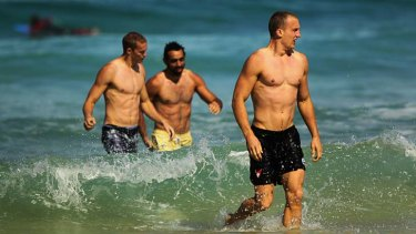 Like Swans to water ... Ted Richards, right, with his Sydney teammates at Bondi yesterday.