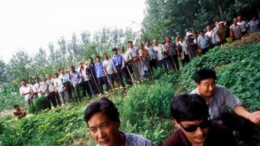 Blind activist lawyer Chen Guangcheng, with the sunglasses, is pictured in front of a group of disabled rural farmers in China.