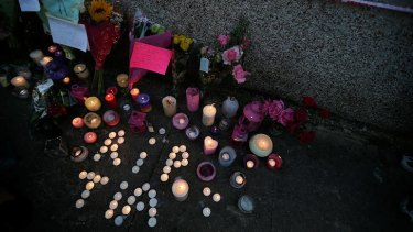 Floral tributes and candles are laid for Tia Sharp.
