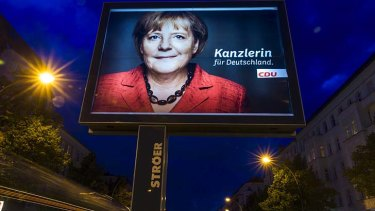 An election campaign poster for German Chancellor Angela Merkel.