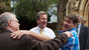 9.45am ...  Mr O'Farrell with the Reverend Bill Crews, left, and a friend at the Ashfield Uniting Church.