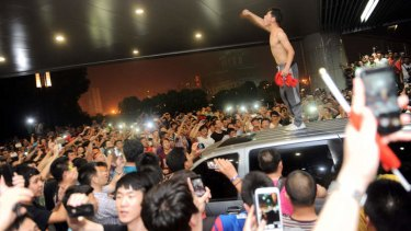 Angry Chinese fans protest after the national team's 5:1 defeat by Thailand on June 15.