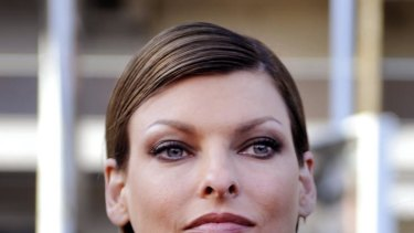 Demand for child support ... model Linda Evangelista.