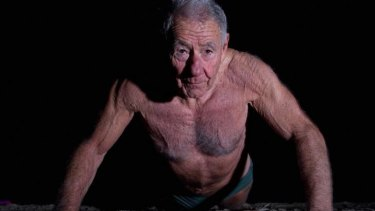 Tom Hafey exercises on the beach as part of his regular early morning training session on June 11, 2011.