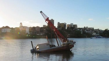 The barge leans at a 30 degree angle in a part of the Brisbane River known as Shafston Reach.