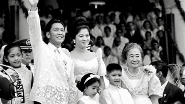 Victorious … Ferdinand Marcos and family in Manila after his inauguration as president in 1965.
