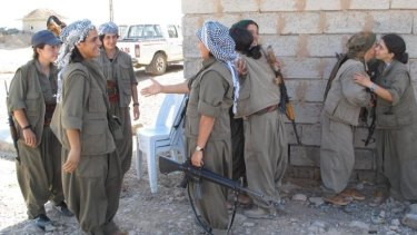 PKK fighters at the Daquq PKK base after a night gathering intelligence on the frontline.