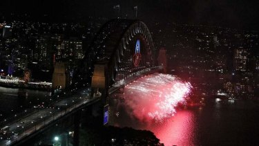 Circular Quay: Fireworks are let off under the Harbour Bridge in the 2013.