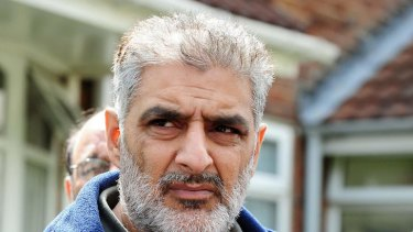 Grief ... Tariq Jahan holds a picture of his son Haroon Jahan.