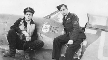 "Flight Lieutenant John William (Jack) ""Slim"" Yarra and Sergeant Robert Ernest (Bob) Yarra standing by the cockpit of Yarra's Spitfire."