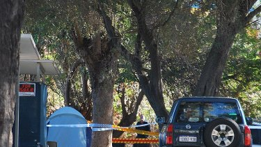 Police officers investigate the scene of the suspected gas bottle blast at a Mandurah caravan park.