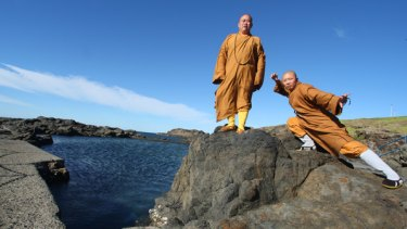 A living tradition of kung fu ... the abbot of the Shaolin Temple in China, Shi Yong Xin, with Shi Yankuo striking a pose.
