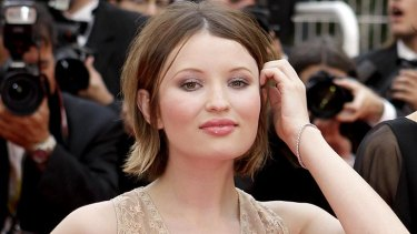 Emily Browning on the red carpet at Cannes. Her tattoo reads 'a blessed unrest that keeps us marching'.