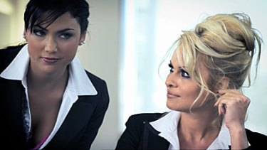 """Pamela Anderson and her """"assistant"""" in a shot from the original offending advert."""