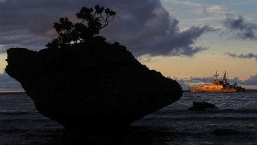 """""""Unfortunate"""" ... a Navy ship is anchored just offshore at Flying Fish Cove on Christmas Island."""