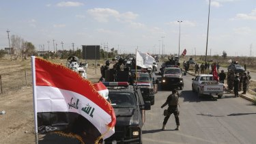 Iraqi security forces prepare to attack Islamic State extremist positions in Tikrit on Thursday.