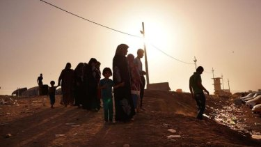 Families outside a displacement camp in Khazair, Iraq. The camp is now home to an estimated 1500 people.