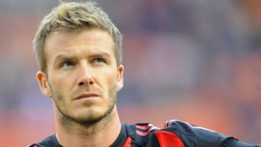 Masculine move ... David Beckham hopes to acquire a deeper voice.