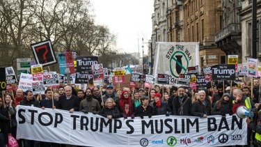 Thousands of protesters with banners and placards marched through central London on Friday.