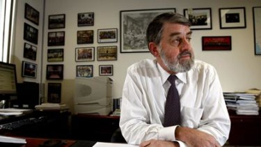 Conference future ... Director of Public Prosecutions Nicholas Cowdery, pictured in his office, has rejected criticism levelled at him by the Attorney-General.