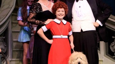 Paws in performance ... Ella Nicol as Annie and, right, Coogee the groodie.