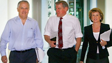 Unmoved ...  Malcolm Turnbull arrives for party talks yesterday with his senior colleagues Ian Macfarlane and Julie Bishop.
