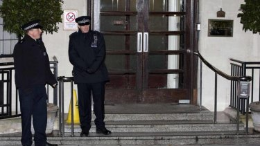 Police stand outside the King Edward VII hospital in central London.