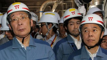 Grim news ... Tepco chairman Kazuhiko Shimokobe, left, and President Naomi Hirose   inspect the No. 4 reactor at Fukushima Dai-ni nuclear power station in Fukushima Prefecture on July 4, 2012.