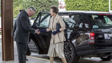 Princess Anne, Princess Royal is greeted by Lord Samuel Vestey.