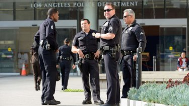 LAPD officers outside police headquarters in February.