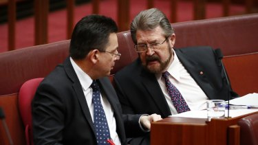 Senators Nick Xenophon and Derryn Hinch during Question Time in the Senate. Hinch pushed for the ban on registered child sex offenders travelling overseas.