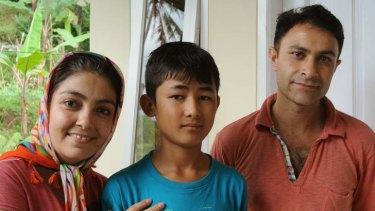 Afghan refugee Omid Jafary, 12, with foster mother Fatima Ramazani and father Majtaba Jafariyam in Cisarua, Bogor, Indonesia.
