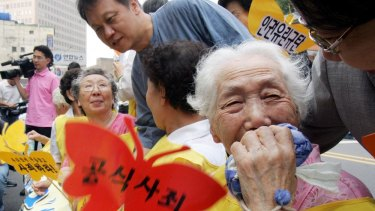 A former South Korean comfort woman Lee Sun-duk, right,  and other comfort women who were forced to serve for the Japanese Army as a sexual slave during World War II.